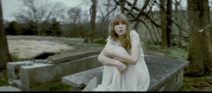 "Taylor Swift in ""Safe and Sound"""